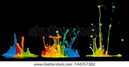 Colored splashes isolated on black background - stock photo