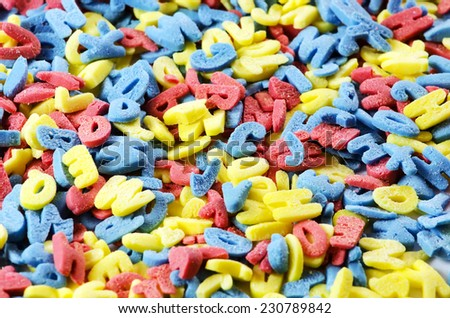 Colored sugar letters.Background image. - stock photo
