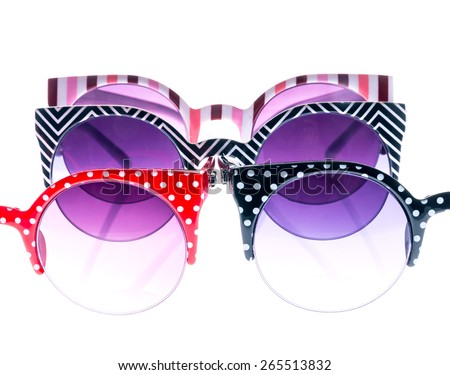 Colored sunglasses on white isolated background