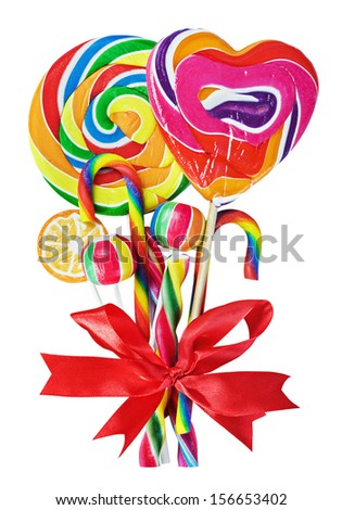 colored sweets with red ribbon bow isolated on white - stock photo