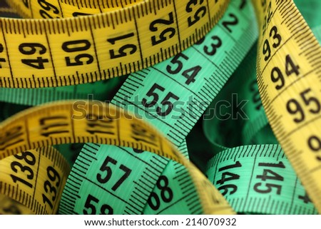 Colored tape measures. Selective focus. Shallow depth of field. Closeup.