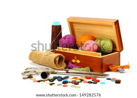 Colored threads, buttons and fabric isolated on white background. - stock photo