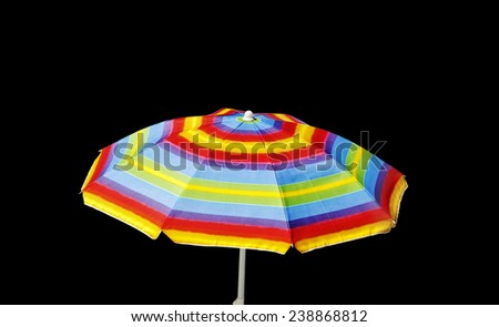 Colored umbrella isolated on black surface. - stock photo
