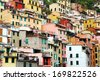 Colores houses in Riomaggiore village, Cinque Terre - stock photo