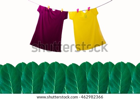 Colorful a summer clothes hang on line on isolated background.
