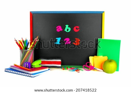 Colorful ABC 123 magnetic letters on a blackboard with school supplies - stock photo