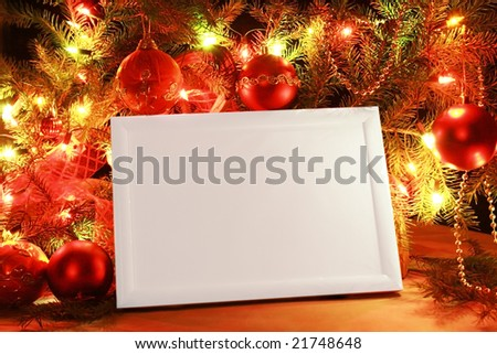 Colorful abstract background with christmas lights and white frame.  Christmas background with Ribbon boll and ornaments - stock photo