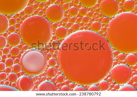 Colorful abstract macro background with oil drops in water - stock photo