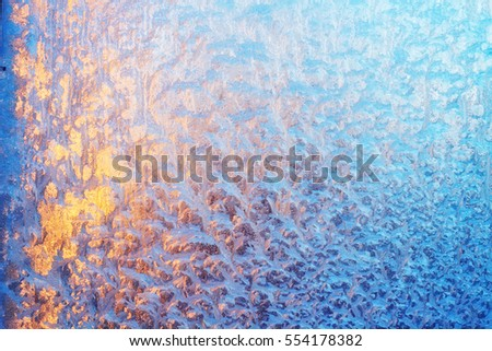 Colorful abstract pattern made by the sun shining through a frosty window