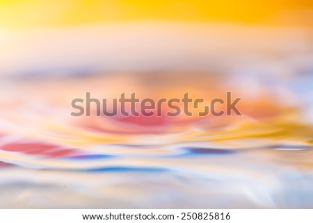 colorful abstraction of moving water surface in close up - stock photo