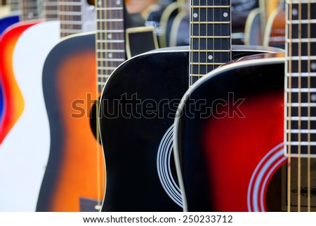 Colorful acoustic guitars - stock photo