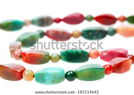 Colorful agate beads isolated on white background, close up - stock photo