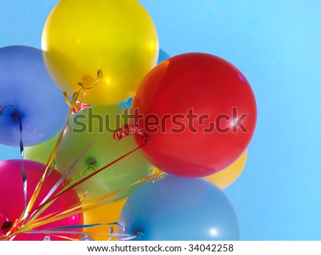 Colorful air balloons over blue sky background - stock photo