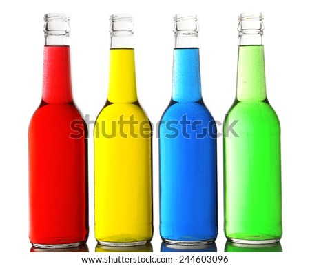 Colorful alcoholic beverages in glass bottles isolated on white - stock photo