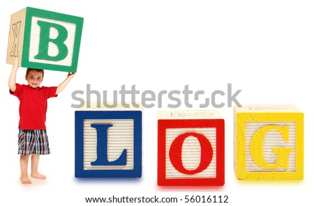 Colorful alphabet blocks spelling the word BLOG with adorable three year old boy. - stock photo