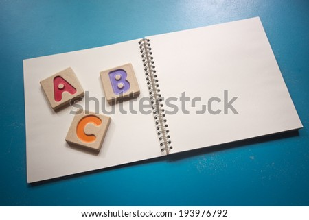 """Colorful alphabet letters ,""""abc"""" on the book - stock photo"""