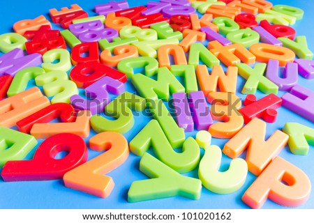 Colorful alphabet on blue background