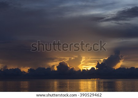 Colorful and beautiful clouds at sunrise with reflection in ocean in Zanzibar, Tanzania.