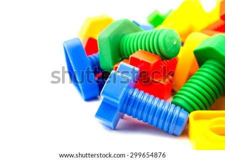 Colorful and funny nuts and bolts toys isolated on white background