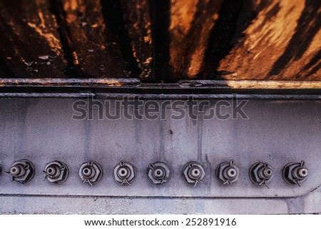 Colorful and rusty background of railway carriage parts. - stock photo