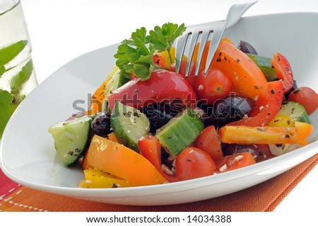 Colorful and tasty vegetable salad in a white bowl.