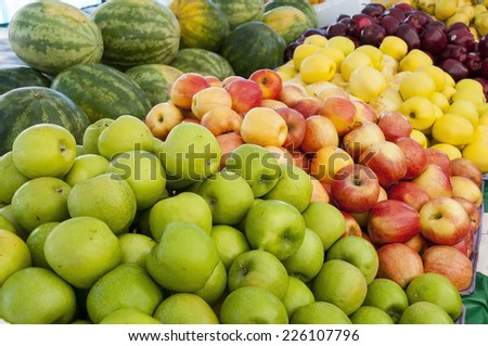 Colorful apples at a farmers market ready to sell - stock photo