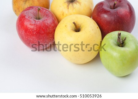 Colorful apples on white background. Fresh ripe apple fruits in different colors: red, yellow, green, orange. macro view.