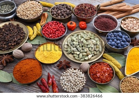 Colorful, aromatic Indian spices on a wooden background. - stock photo