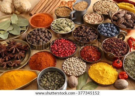 Colorful, aromatic spices in bowls on the table. - stock photo