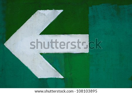 Colorful Arrow sign painted on a wall