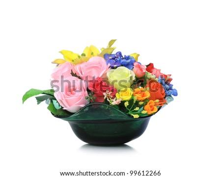 Colorful Artificial Flower Arrangement on white background - stock photo