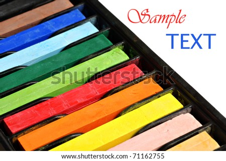 Colorful artists pastels on white background with copy space.  Macro with shallow dof. - stock photo