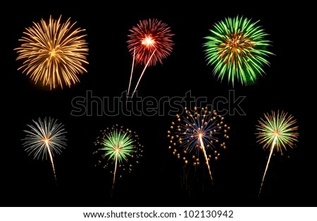 Colorful assorted fireworks selection on a black background. - stock photo