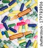 Colorful assortment of pills and capsules - stock photo