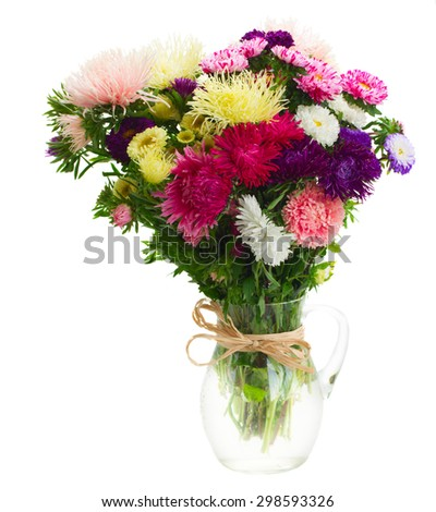 colorful  aster flowers bouquet in glass vase isolated on white background - stock photo