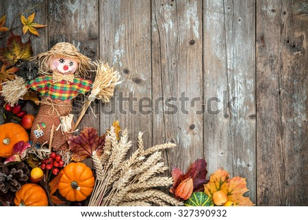 Colorful autumn background with a scarecrow decoration for Halloween and Thanksgiving - stock photo