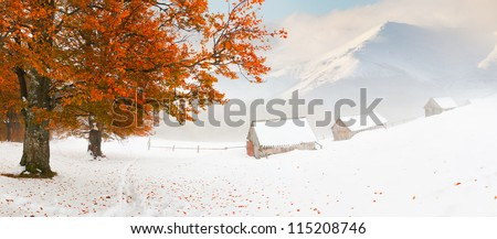Colorful autumn landscape in the mountains. First snow in November - stock photo