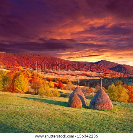 Colorful autumn landscape in the mountains village. Sunset - stock photo
