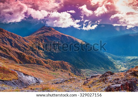Colorful autumn morning in the Caucasus mountains. Upper Svaneti, Georgia, Europe. October 2015. - stock photo