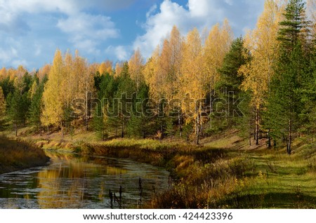 Colorful autumn on calm river in sunny morning - stock photo