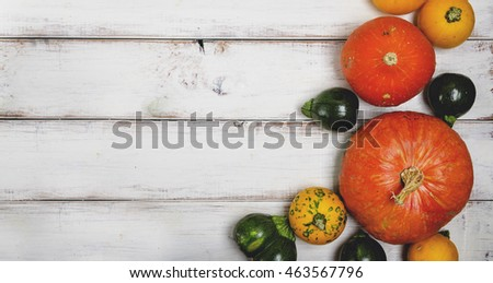 Colorful autumn pumpkins on white wooden table. Halloween and thanksgiving background concept.
