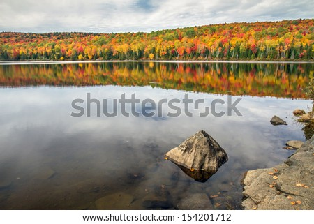 Colorful Autumn reflection - stock photo