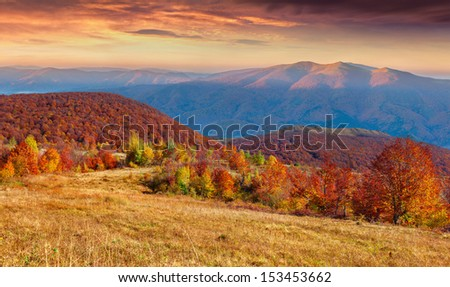 Colorful autumn sunset in the mountain - stock photo