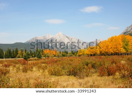 Colorful autumn view of rocky mountains and forests in kananaskis country, alberta, canada - stock photo