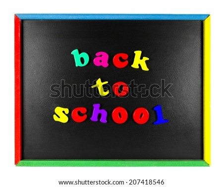 Colorful Back To School magnetic letters on a blackboard isolated on white - stock photo
