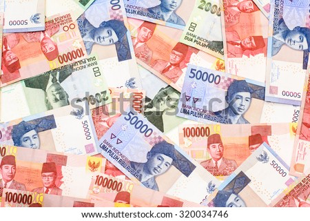 Colorful background and texture of Indonesia Rupiah currency,money got profit from business - stock photo