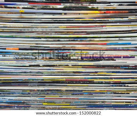 Colorful background made of stacked magazines - stock photo
