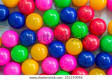 colorful ball, children's party, a games room, a box filled with small colored balls - stock photo