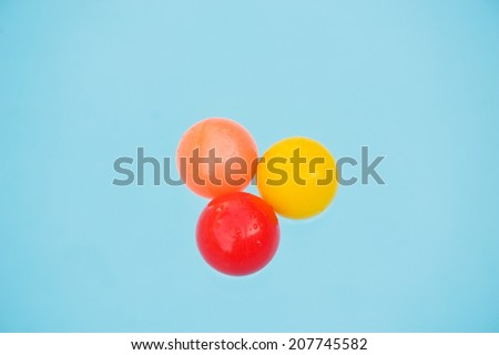Colorful ball floating in a pool - stock photo