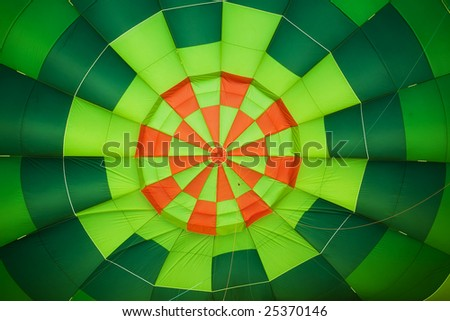Colorful balloon interior creating green and orange background. - stock photo